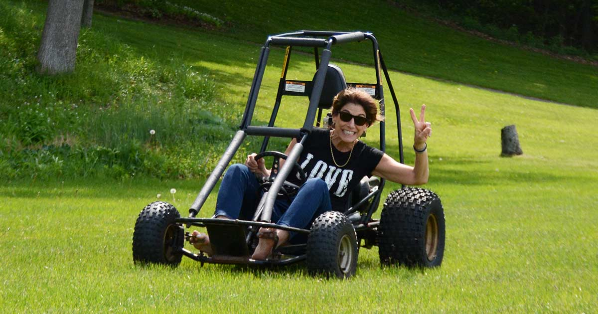 Kelly Farrell of designRoom driving a go cart